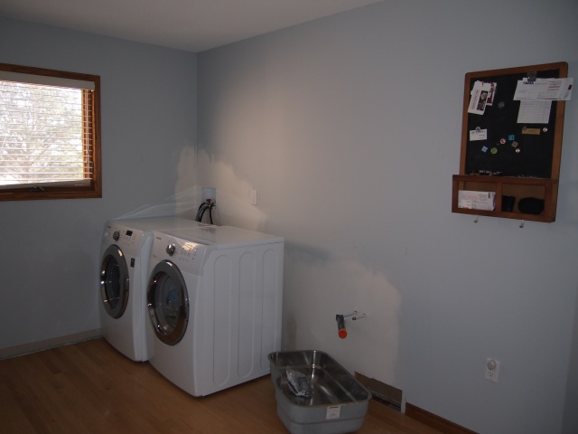 The wall is repaired and the washer and dryer are moved over