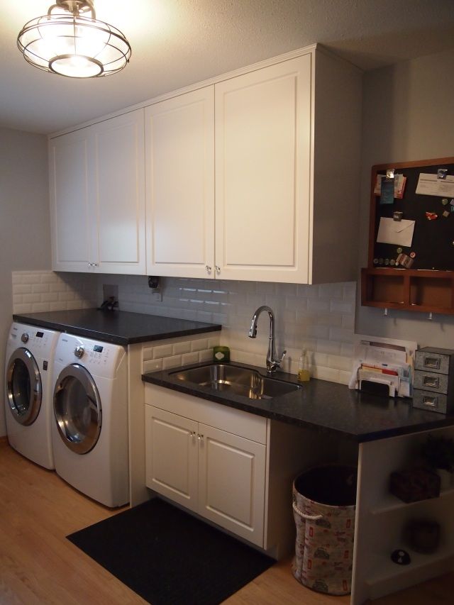 Washer and dryer tucked under a countertop, deep sink for handwashing clothes, or filling car washing buckets, a spot for my laundry basket, and an organization station for all those papers!